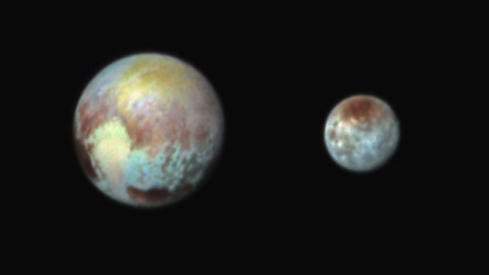 Pluto and Charon Shine in False Color (Photo credit: NASA)