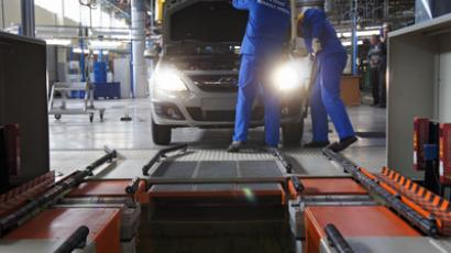 Peugeot blames crisis for 8,000 job cuts