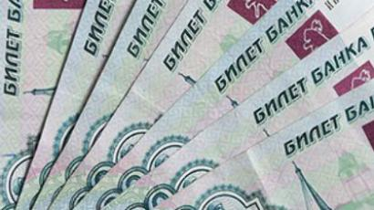 Russian economy coping well but caution remains