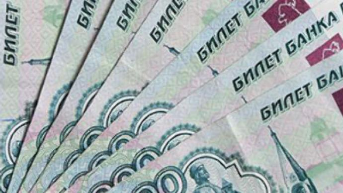 Rouble a spectator in currency drive to the bottom