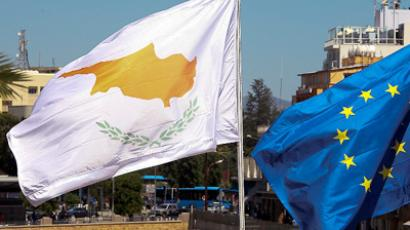 Cyprus hit by another downgrade from S&P, deal with Troika is questioned