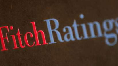 Fitch cuts Spain's rating three notches to BBB