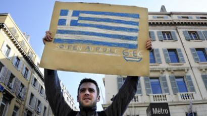 Greece agrees to raise retirement age, discusses further cuts