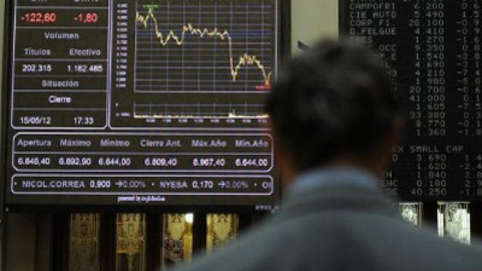 Markets fall under Moody's attack on Spain
