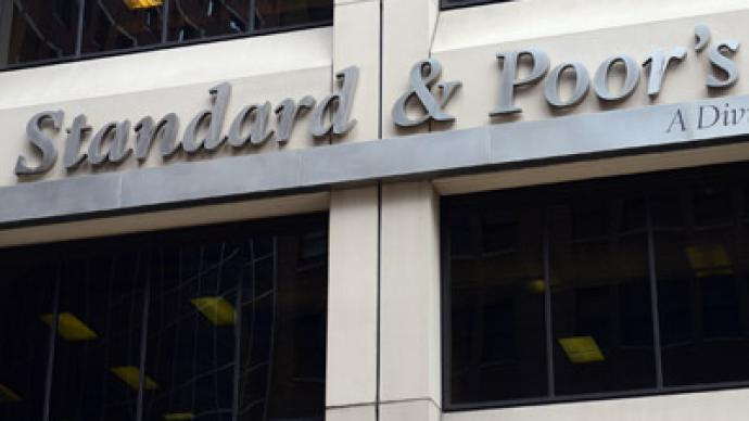 S&P downgrades 15 Spanish lenders