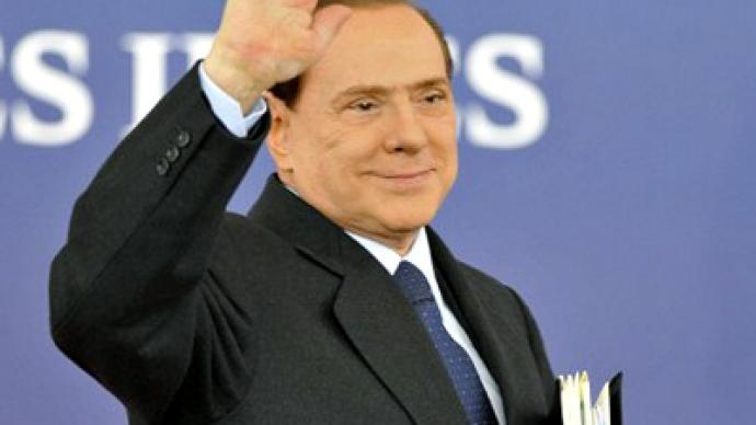 A sea of red as Berlusconi steps down