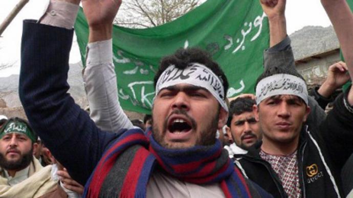 Afghan soldier killed at massacre scene as Afghans rage on streets