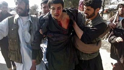 Afghan soldier killed at massacre scene as Afghans rage on streets