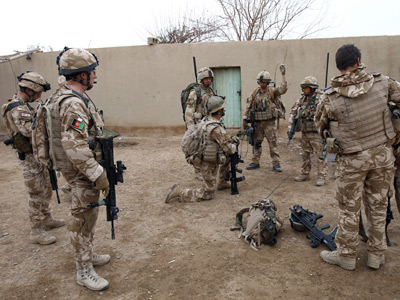 UK may speed troop pullout in 2013 over Marines shooting scandal