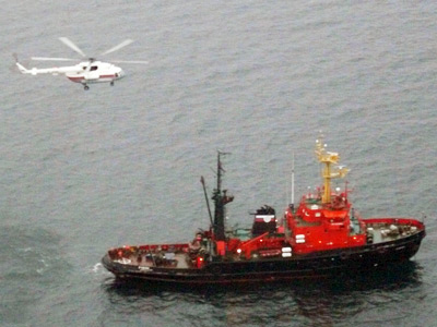 Divers recovery body from sunken gold ship, 8 crew still missing