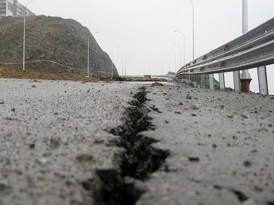 Down the drain in the rain: $1 billion highway washed away in Far East (PHOTOS)