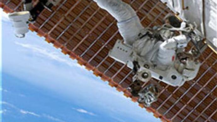 Astronauts' spacewalk shortened by Hurricane Dean