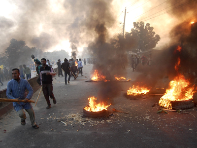 Arrests, protests as Bangladesh building death toll rises to 352