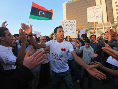 Intelligence HQ in Libyan capital under grenade attack, militias clash outside