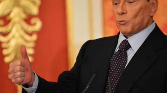 Berlusconi feels 'obliged' to stay in politics despite fraud conviction