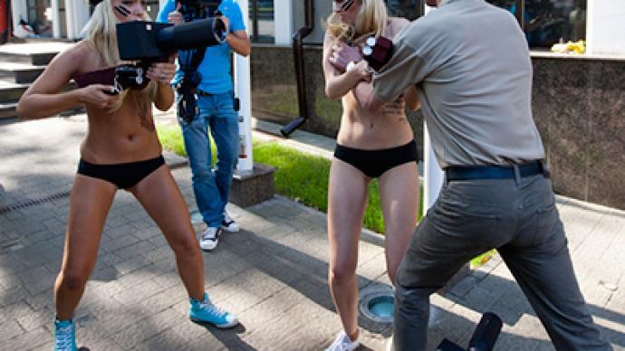 Georgian embassy staffer attacks topless protesters