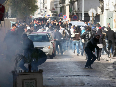 National strike, protests and clashes as Tunisia mourns for assassinated opposition leader