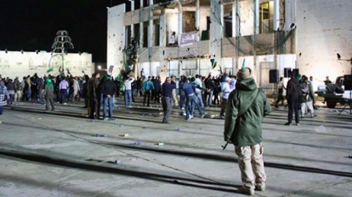 Coalition forces strike Gaddafi compound