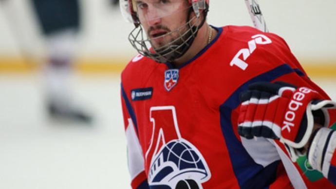 Crash-survivor hockey player stable, in induced coma