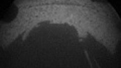 Mars 'Curiosity' stuns scientists, stirs speculation