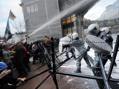 Belgian police fire water cannons to disperse striking ArcelorMittal workers