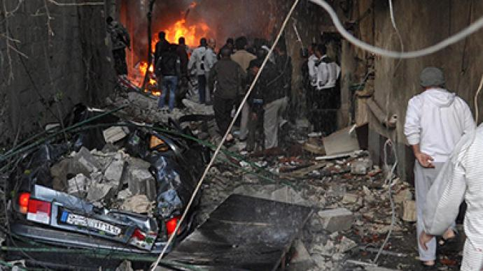 At least 34 people killed in twin blasts in Damascus