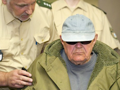 Germany under pressure to jail fugitive SS death squad officer