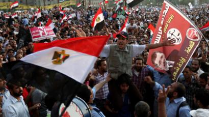 Clinton and Morsi hold talks in Cairo amid protests (VIDEO)