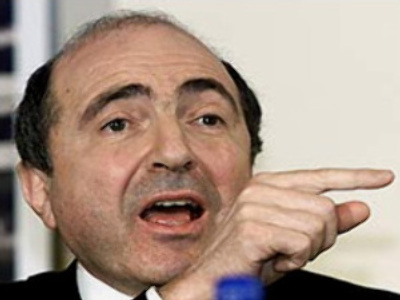 Exiled tycoon charged with plotting coup - lawyer