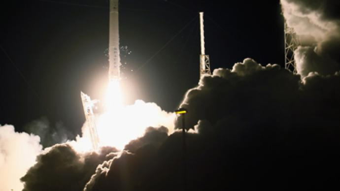 Dragon flies high: NASA's first private freighter blasts off