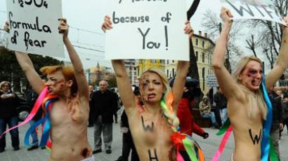 Topless attack: FEMEN dump Euro trophy in protest (PHOTOS, VIDEO)