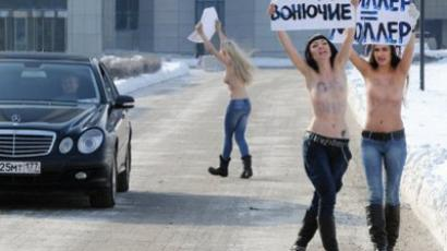 FEMEN rings the bell: Naked activists defend right to abortion (VIDEO, PHOTOS)