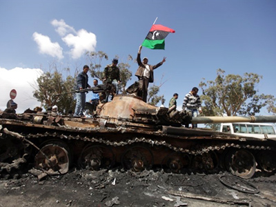Libyan rebels cage black Africans in zoo, force feed them flags (SHOCK VIDEO)