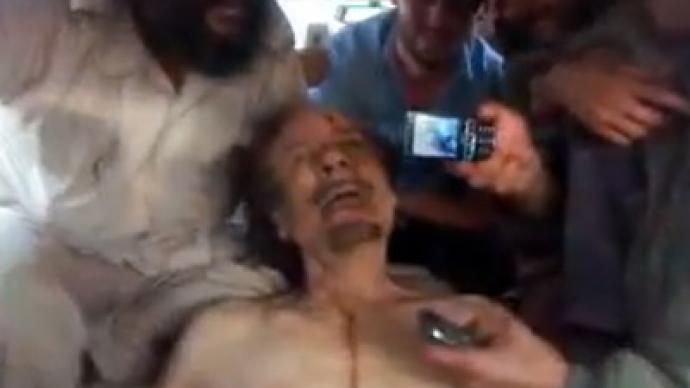 'Send this to Assad': New shock video shows rebels mocking Gaddafi body