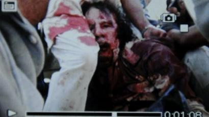Captured Gaddafi covered in blood - FIRST PHOTO
