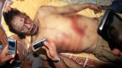 Gaddafi died from gunshot wound - autopsy
