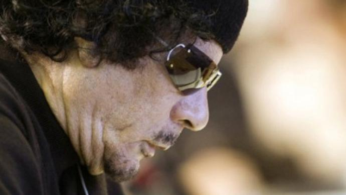 Finally at rest: Gaddafi's rotting corpse buried