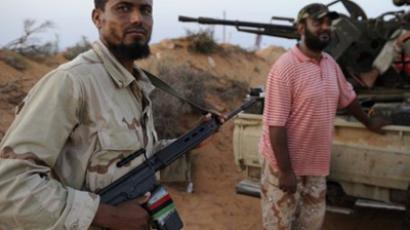 Gaddafi 'remains in Libya against all odds'