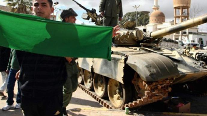 Gaddafi winning ground war, coalition battles on