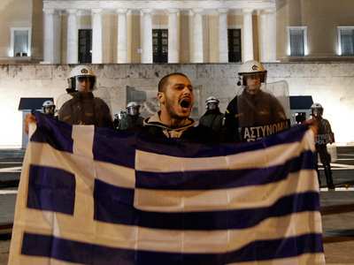 Debt deals and downgrades: Fitch sours Greek bondholder deal