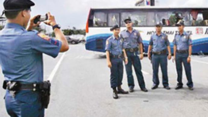 Filipino cops face demotion over posing in front of hijacked bus