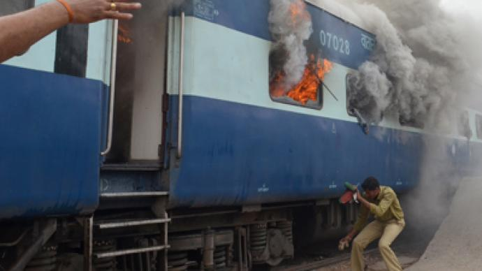 Train fire kills dozens in India