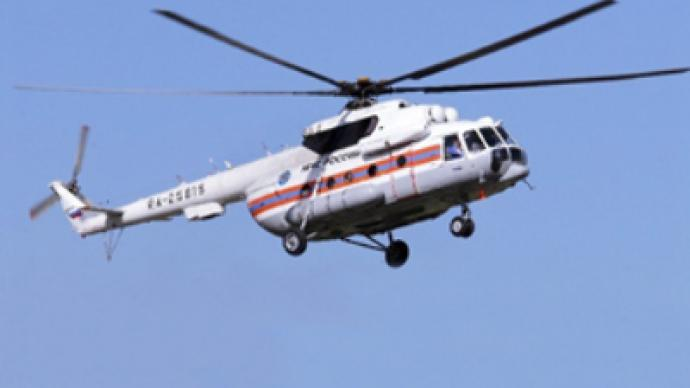Investigators arrive at the scene of helicopter crash in Altay
