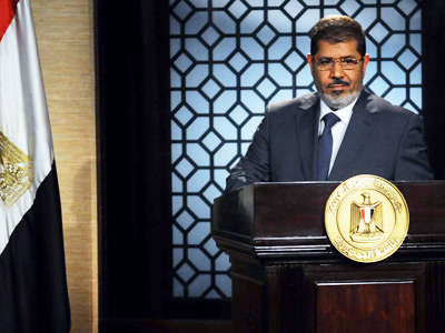 President Morsi hails 'new Egypt' but faces challenges to authority