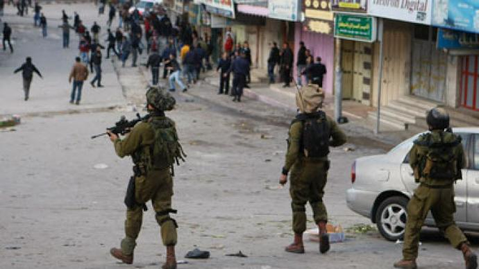 Hebron brawl: IDF soldiers clash with Palestinian police