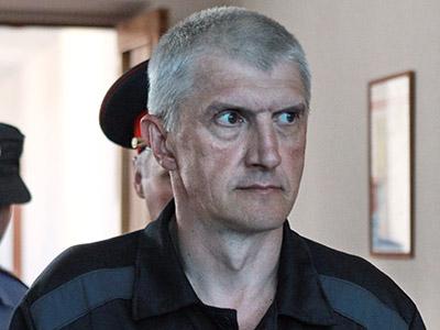 Moscow court reduces jail term for Khodorkovsky, partner