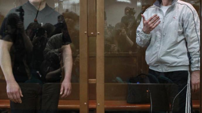 Moscow court reduces jail term for Khodorkovsky, partner