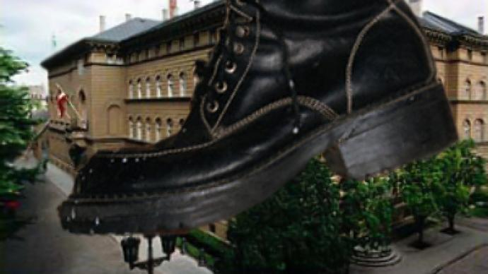 Latvians stage shoe-throwing protest