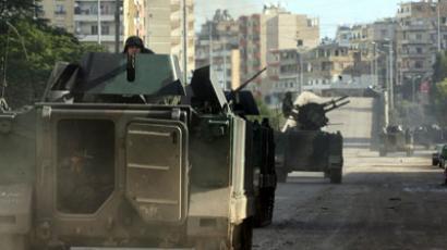Damascus warns of strike on Syrian rebels hiding in Lebanon