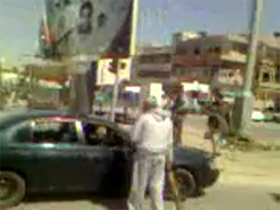 Militia and Gaddafi loyalists clash outside Tripoli